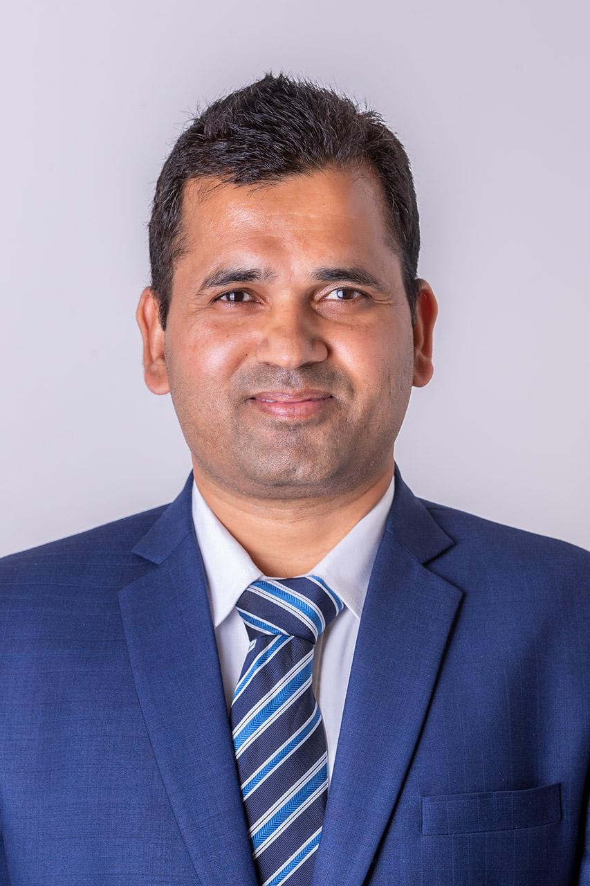 Dr. Tej Singh